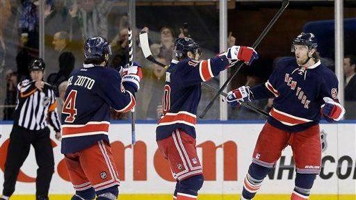 Rick Nash, right, celebrates his goal with teammates