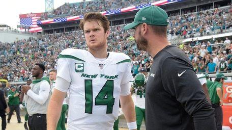 Jets head coach Adam Gase, right, talks to
