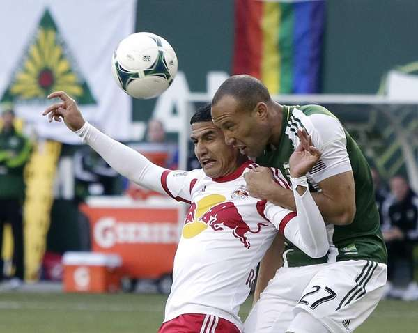 Portland Timbers defender Mikael Silvestre, right, and New