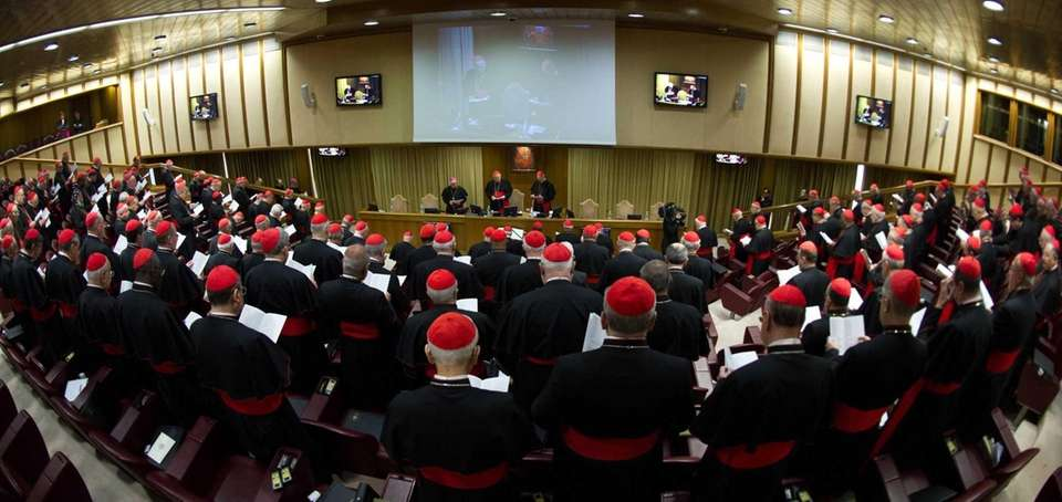 Cardinals attend a meeting at the Vatican. Cardinals