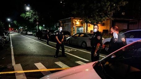 NYPD officers on Atlantic Avenue in Brooklyn earlier