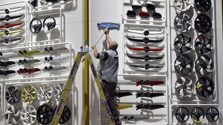 A worker cleans at the Opel booth during