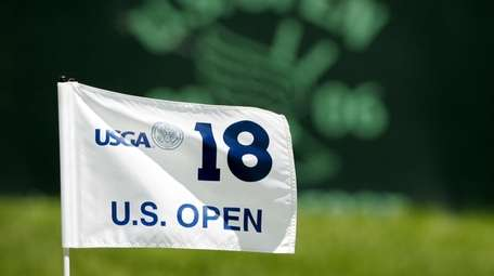 The flag on the 18th hole flaps in