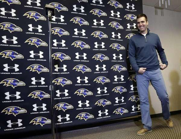 Baltimore Ravens quarterback Joe Flacco walks up to