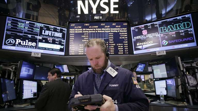 Trader Thomas Lyden works at the New York