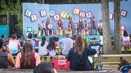 "Children perform ""Matilda Jr."" outdoors at Fireman's Memorial"