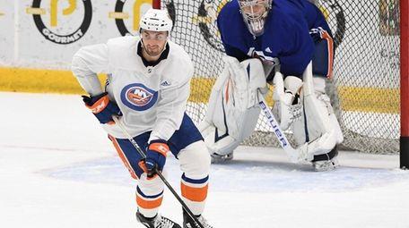 Islanders defenseman Adam Pelech skates with the puck
