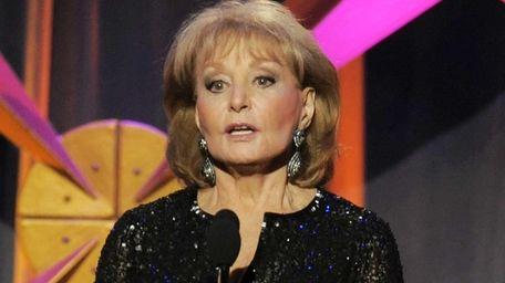 Barbara Walters presents an award at the 39th