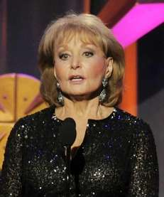 Barbara Walters presents an award at the 39th
