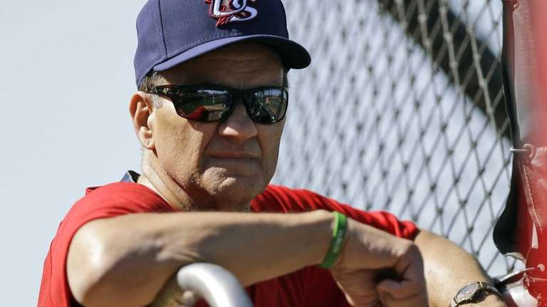 United States manager Joe Torre watches batting practice