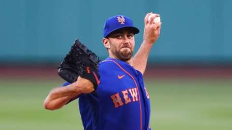 David Peterson of the Mets pitches in the