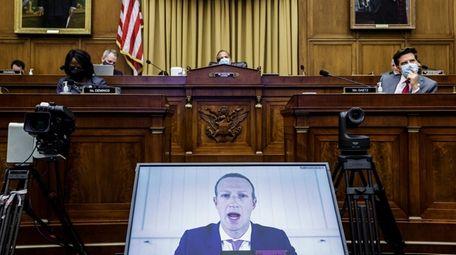 Facebook CEO Mark Zuckerberg speaks via video conference