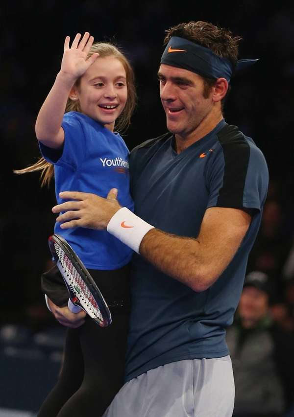 Juan del Potro celebrates with a fan from