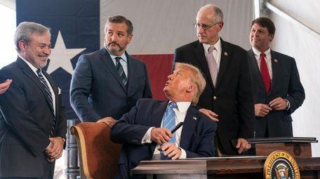 President Donald Trump speaks to Sen. Ted Cruz,