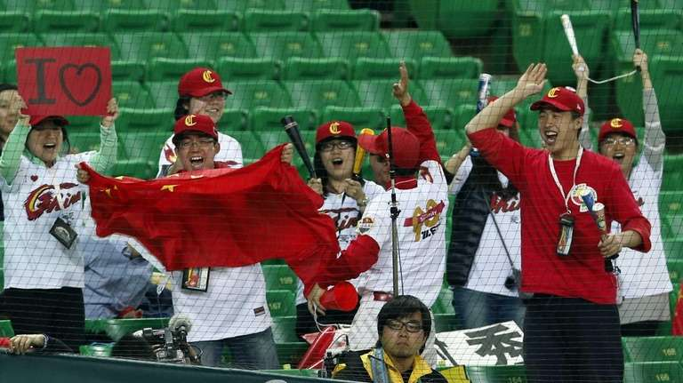 Chinese fans cheer during a World Baseball Classic