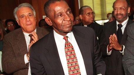 William J. Willet (center) became Nassau County's first