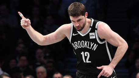 Brooklyn Nets forward Joe Harris reacts after he