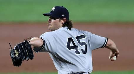 Gerrit Cole of the Yankees throws to a