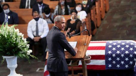 Former President Barack Obama delivers a eulogy at