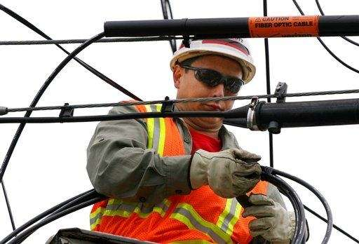 Verizon lineman Clemente Calma installs fiber optic cable