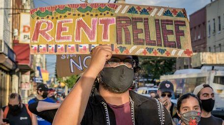 Demonstrator seeks aid for tenants in Brooklyn.