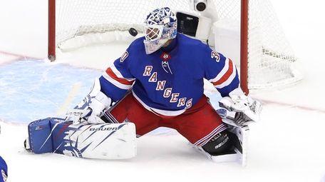 Henrik Lundqvist #30 of the Rangers is unable