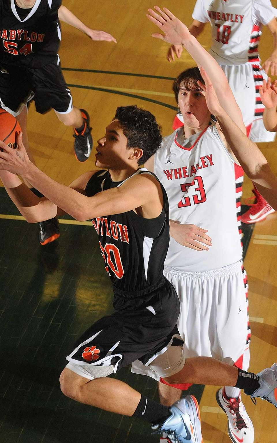Babylon's Fernando Vazquez drives past Wheatley's Sam Fieldman