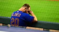Pete Alonso #20 of the Mets watches play