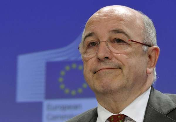 European Union Commissioner Joachim Almunia listens to a