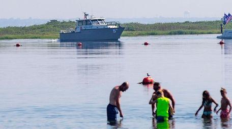 Nassau police patrol Zach's Bay after a possible