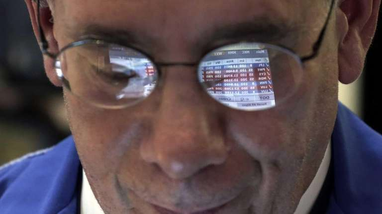 Trader Sal Suarino's glasses reflect the screen of