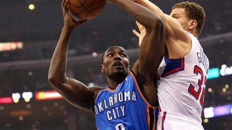 Oklahoma City Thunder forward Serge Ibaka goes up