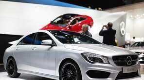 A Mercedes-Benz CLA-Class automobile is seen on display