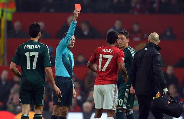 Turkish referee Cuneyt Cakir, second from left, shows