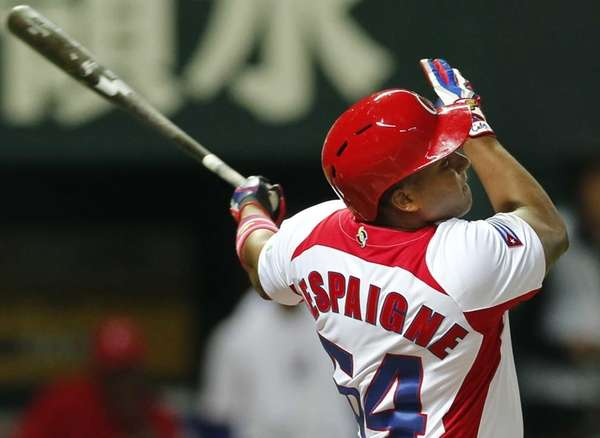 Cuba's Alfredo Despaigne hits a three-run homer off