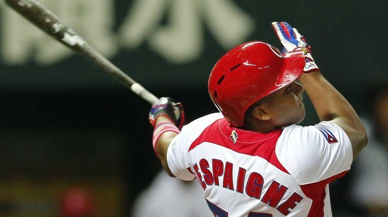 Cuba's Alfredo Despaigne hits a three-run homer off