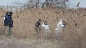 Investigators scope out a crime scene next to