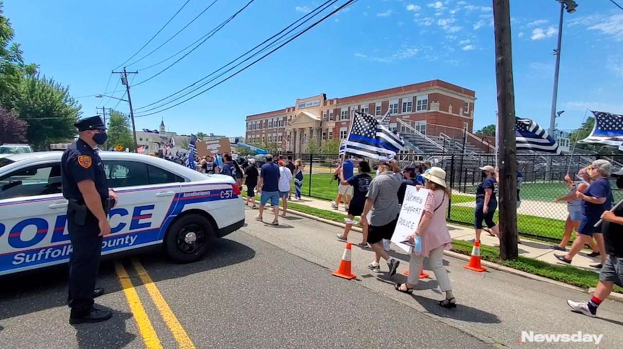 Demonstrators gathered in Sayville on Saturday in support