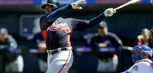 Atlanta Braves outfielder Justin Upton hits a home