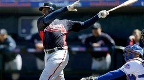 Atlanta Braves outfielder Justin Upton hits a home