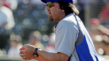 Italy hitting coach Mike Piazza watches from the