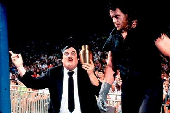 The Undertaker, right, made his WWE debut in