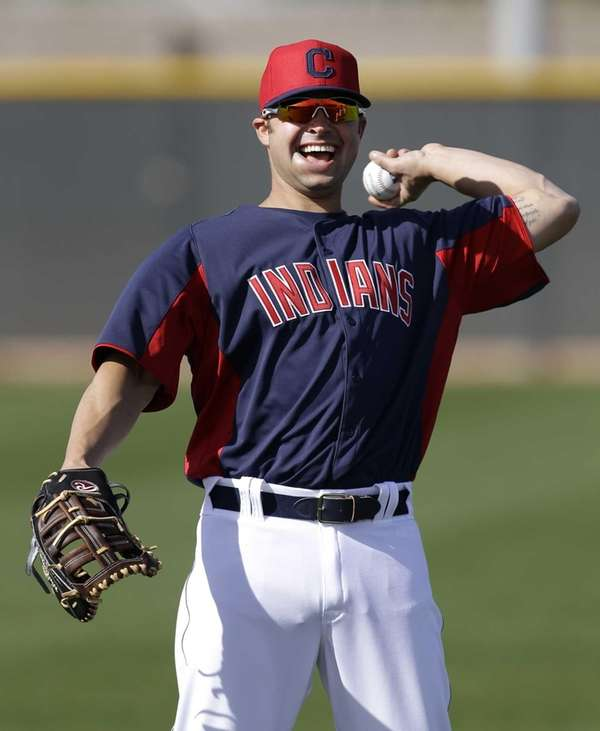 Cleveland Indians' Nick Swisher throws during a spring