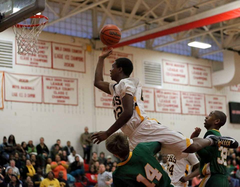 Bridgehampton's Jason Hopson goes up over Coleman Catholic's