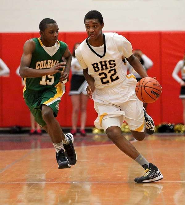 Bridgehampton's Jason Hopson moves past Coleman Catholic's Micah