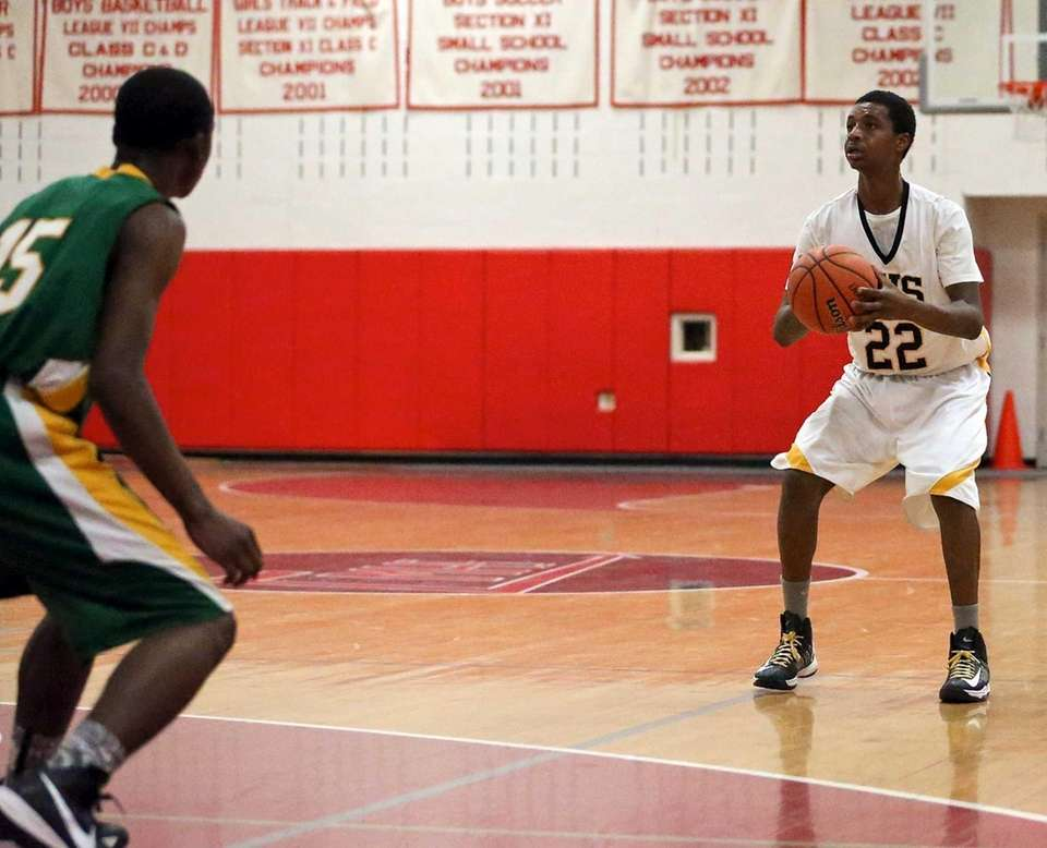 Bridgehampton's Jason Hopson prepares to shoot a three