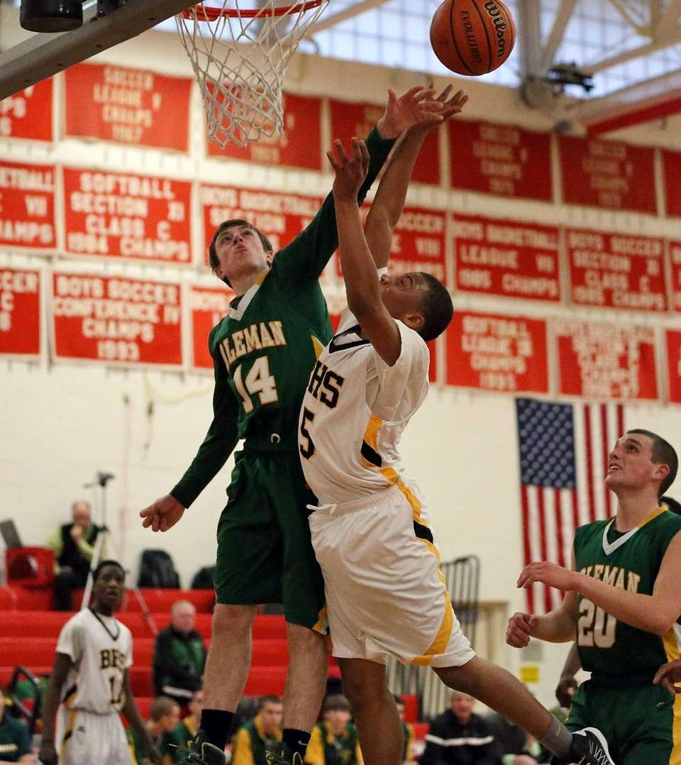 Bridgehampton's Tylik Furman has his shot blocked by
