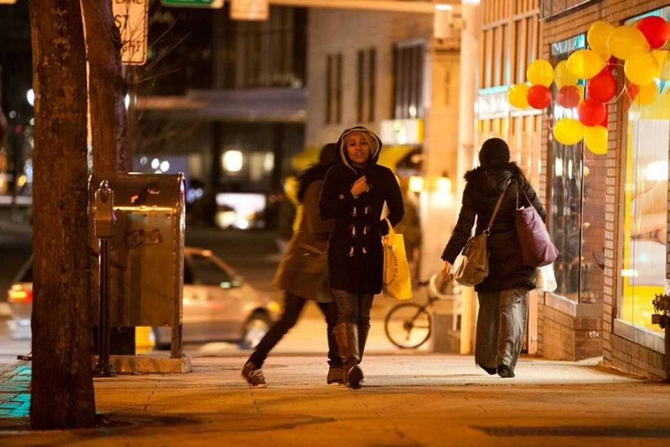 Pedestrians brace themselves against the cold in downtown