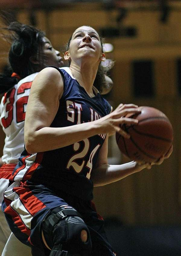 St. John the Baptist's Lauren Parra tries to