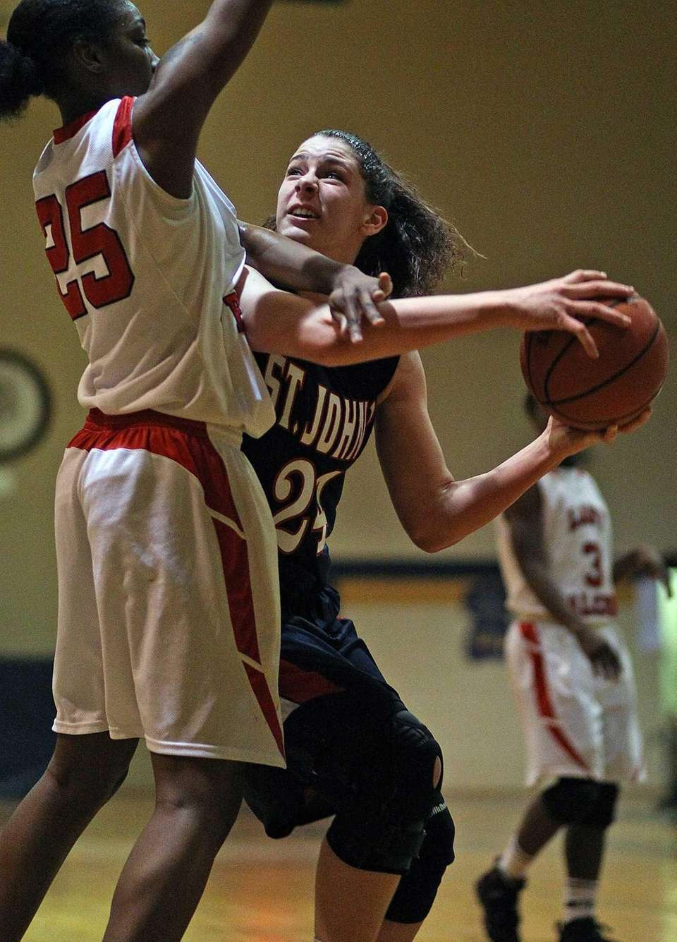 St. John the Baptist's Lauren Parra tries for